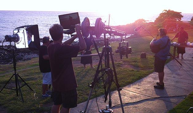 camera crew near the beach.